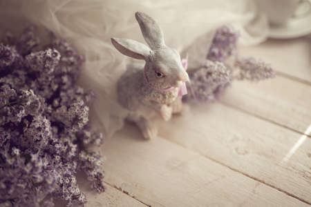 Gentle spring background with lilac and rabbit