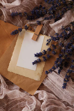 a pack of old letters and notes on a background of pink cloth