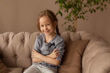 Portrait of a seven year old girl at home Banque d'images