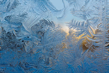winter window: Beautiful natural frosty pattern on winter window.