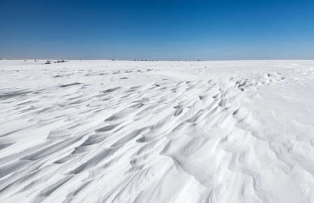 snowdrifts: Snowdrifts on winter field in freezing weather Stock Photo
