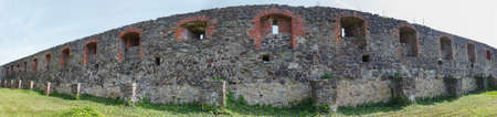 loophole: Ancient fortress wall with loophole protecting castle Editorial