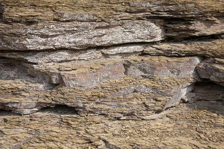 rock strata: Ancient rock strata closeup. Rock layers background. Stock Photo