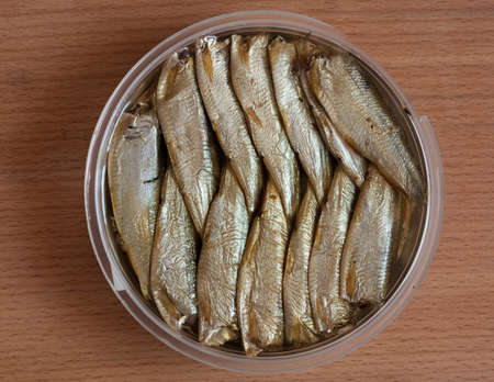 Smoked sprats neatly packed in a can