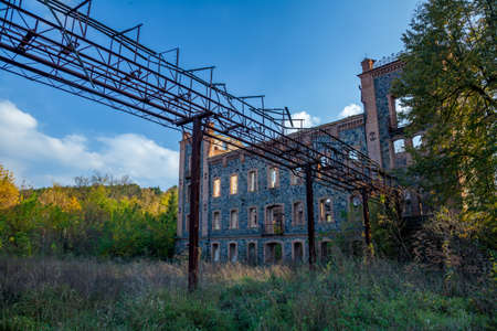 Old destroyed factory building worn out by time