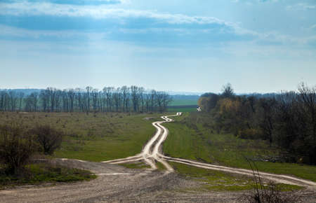 Country dirt road leaving into the distance Stok Fotoğraf