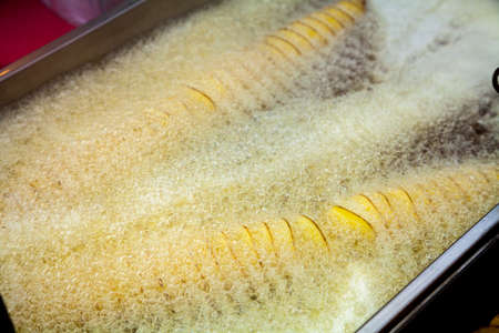 Potatoes sliced spitalyu fried in boiling fat