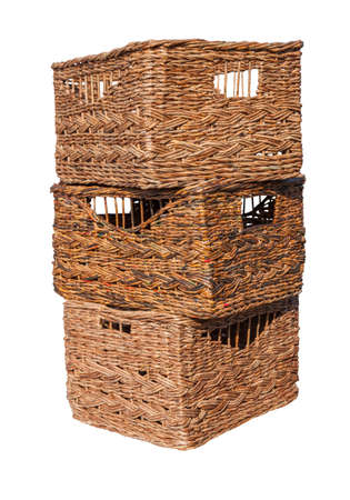 Wicker boxes made of waste paper isolated on white background