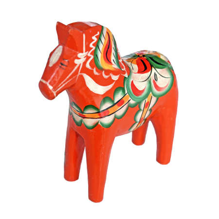 Wooden horse figurine on a white background.