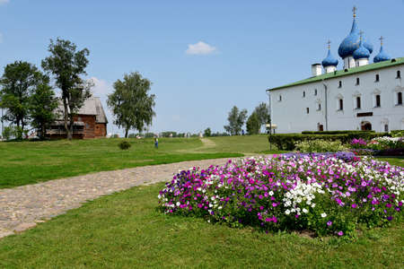 Flowerbed on the background of the attractions of the city of Suzdal.