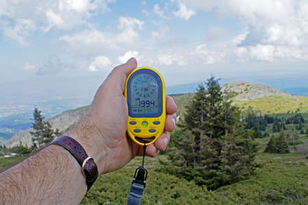 Altimeter, a device for determining the height above sea level, in the hand of a tourist during a hike on mount Vitosha near the Bulgarian capital Sofia.