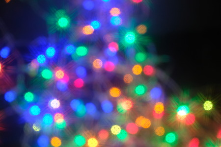 Defocused abstract multicolored bokeh lights background. Selective focus