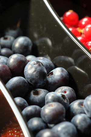 plastic containers box of berries, red currants and blueberries. Close up 版權商用圖片