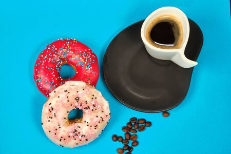 doughnuts and a Cup of coffee on a blue background, Stockfoto