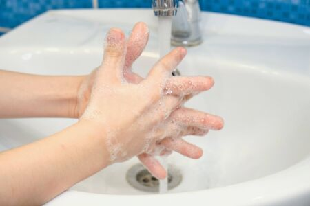 Wash your hands with soap and running water.