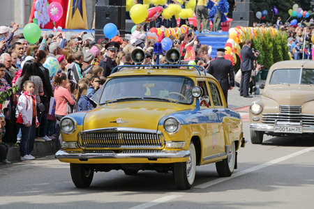 militia: The rare car of militia heads a column of a retro of cars on parade in honor of anniversary of the Victory in the Second World War. Pyatigorsk. Russia