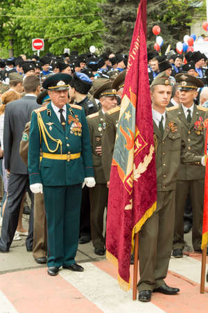 road warrior: PYATIGORSK, RUSSIA - MAY 9 2014  Victory Day in WWII  Standard-bearers and column of people