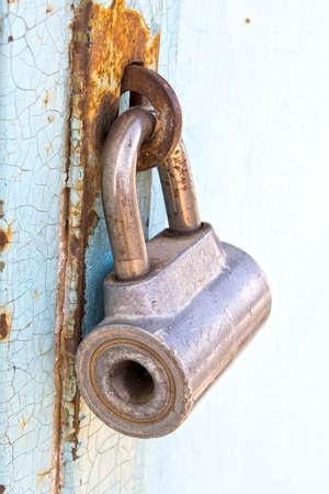 The old padlock on iron gate photo