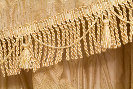 Detail of curtains with fringe and tassels, background
