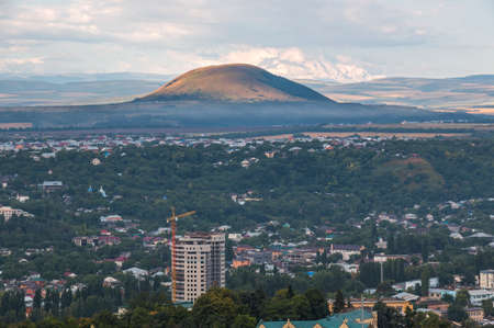 View from the mountain Mashuk to Pyatigorsk  Russia  and Elbrus in the morning photo