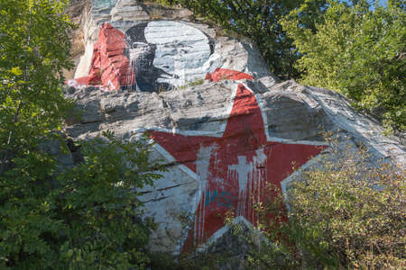 soiled: PYATIGORSK, RUSSIA - AUGUST 15, 2014: Lenins portrait soiled by paint and inscriptions on the mountain Mashuk in Pyatigorsk Editorial