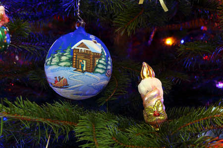 Christmas decorations in the form of a ball and candle (background) photo
