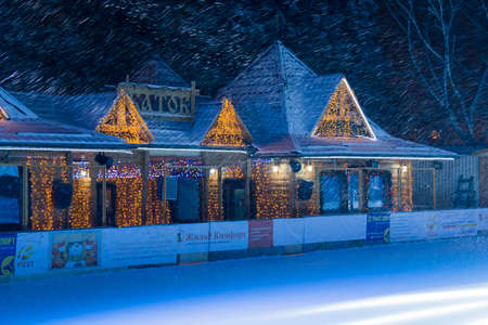 pyatigorsk: PYATIGORSK, RUSSIA - DECEMBER 31, 2014: View of the outdoor ice rink in front of the administration of the city of Pyatigorsk Editorial