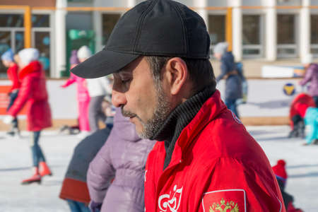 duffle: PYATIGORSK, RUSSIA - JANUARY 4, 2015: Trainer at the open-air ice rink