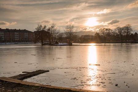 Evening view on a frozen pond in the winter in a city park in Pyatigorsk, Russia photo