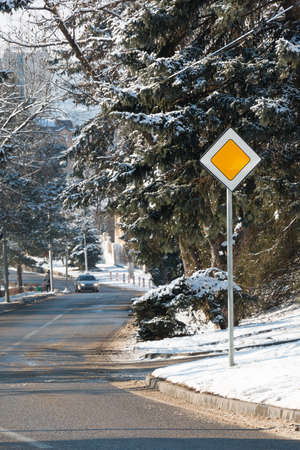 dividing lines: Street of the city in winter. Traffic sign the main road