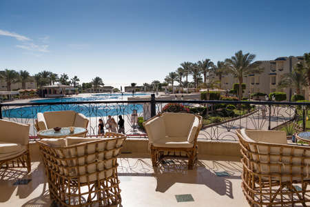 cane chair: SHARM EL-SHEIKH, EGYPT - NOVEMBER 30, 2014: Tables and chairs on the terrace of the hotel Grand Oasis Resort Editorial
