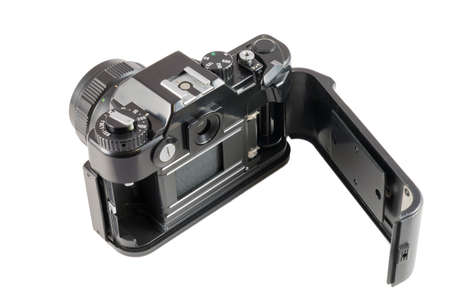 broach: Old black SLR camera with open back cover. View of a shutter and mechanism of a broach of a film
