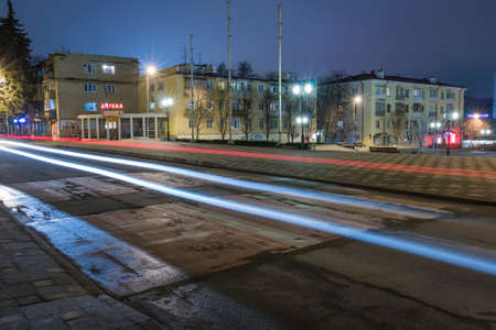 Night view Kozlov Street in Pyatigorsk (Russia). Traces of passing cars