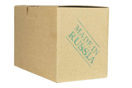 made in russia: Side view of a cardboard box stamped MADE IN RUSSIA isolated on white background