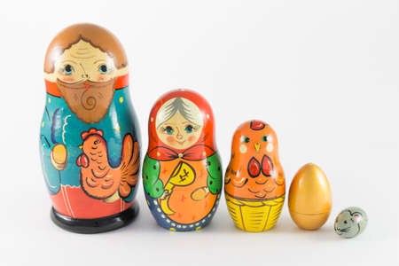 russian nested dolls: Pyatigorsk, Russia - February 21, 2015: Nesting dolls based on the story \Hen Ryaba\ in a row on a white background