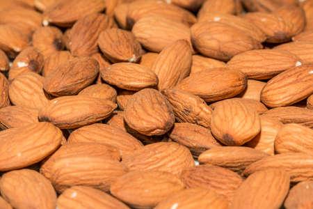shelled: Shelled sweet almonds closeup, background