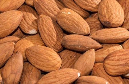 Shelled sweet almonds closeup, background photo