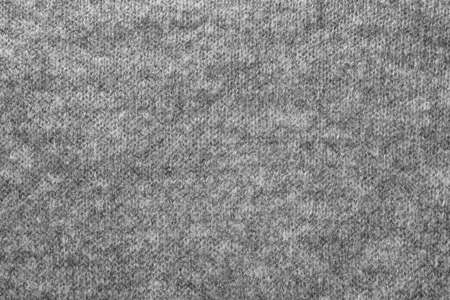 Texture of gray knitted wool fabric (background) Stock Photo