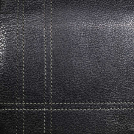 stitched: Black leather stitched thread vertically and horizontally, background