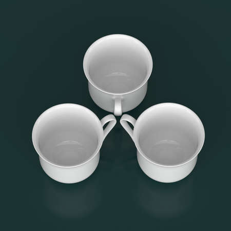 porcelain: Top view of a group of three porcelain cups on a dark background