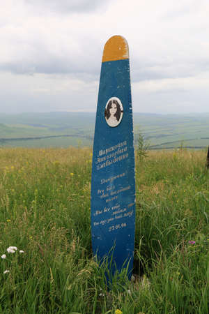 all love: Mountain Yutsa, Russia - June 12, 2015: Monument to killed in crash girl Marina Davydenko she was a paraglider pilot on a mountain top Yutsa. The inscription in Russian: My daughter! That was your last flight ... We all love you!