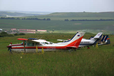 airfield: Mountain Yutsa, Stavropolsky Region, Russia - June 12, 2015: Planes at the airfield Yutsa in cloudy weather