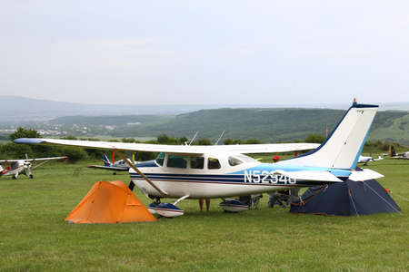 light aircraft: Mountain Yutsa, Stavropolsky Region, Russia - June 12, 2015: Light aircraft between two tents in Yutsa airfield in cloudy weather