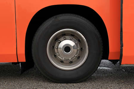 hubcap: Wheel with damaged rim on a wet asphalted road Stock Photo