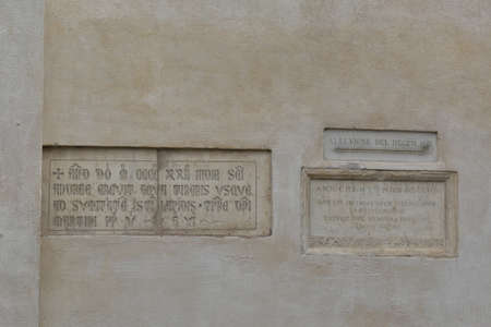 minerva: Piazza della Minerva. Memorials to the flooding of the River Tiber between 1422 and 1598 on wall of church of Santa Maria sopra Minerva in Rome. Editorial
