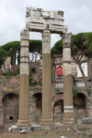 reconstructed: Three reconstructed columns on a place of the Roman Forum. Rome, Italy Editorial