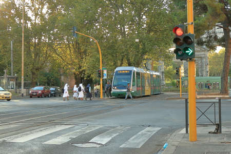 nuns: Rome, Italy - August 17, 2015: Nuns entering in the tram at the Piazza Di Porta Maggiore  in the early morning