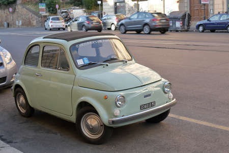 celadon green: Rome, Italy - August 17, 2015: Old retro car Fiat 500 of pistachio color is parked on street in Rome.