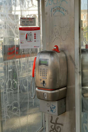 payphone: Rome, Italy - August 17, 2015: The metallic payphone TELECOM ITALIA in a phone booth close up