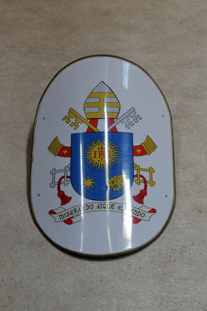 mario: Coat of arms of Pope Francis Jorge Mario Bergoglio on a wall in Basilica in Rome, Italy